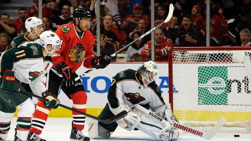 Minnesota Wild goalie Josh Harding, right, cannot save a goal by Chicago Blackhawks' Marian Hossa (81) as Wild's Zach Parise (11) and Jared Spurgeon (46) look on during the second period of Game 5 of an NHL hockey Stanley Cup first-round playoff series in Chicago, Thursday, May 9, 2013. (AP Photo/Nam Y. Huh)