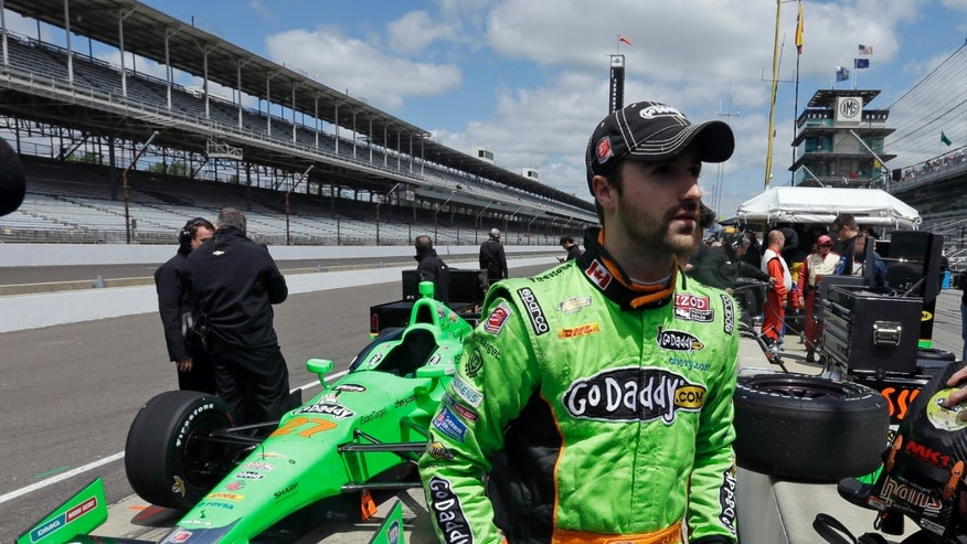 James Hinchcliffe walks away from his car after practice for the Indianapolis 500 auto race at the Indianapolis Motor Speedway in Indianapolis, Sunday, May 12, 2013. (AP Photo/Darron Cummings)