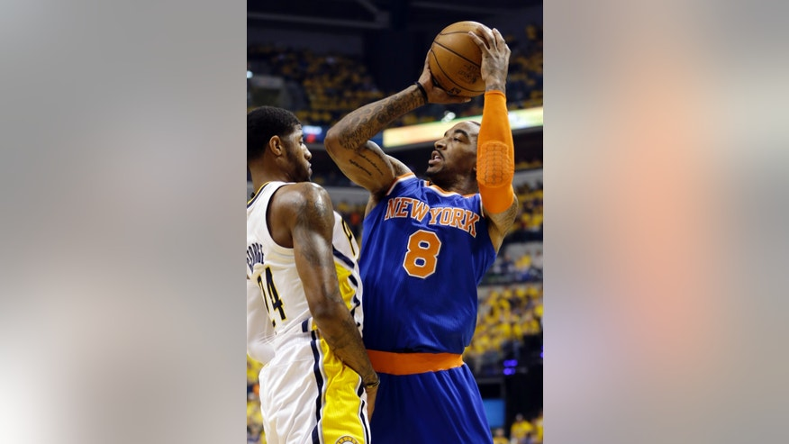New York Knicks' J.R. Smith (8) shoots over Indiana Pacers' Paul George (24) during the first half of Game 3 of an Eastern Conference semifinal NBA basketball playoff series in Saturday, May 11, 2013, in Indianapolis. (AP Photo/Darron Cummings)