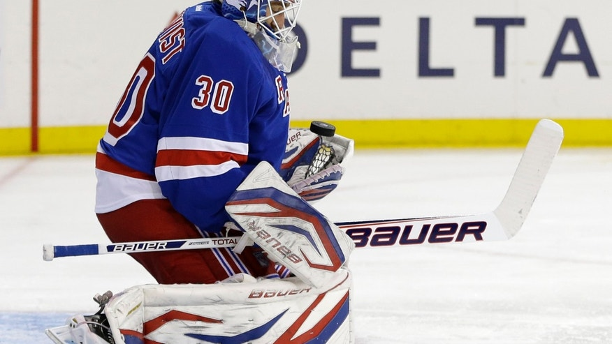 New York Rangers goalie Henrik Lundqvist (30), of Sweden, makes a save against the Washington Capitals in the first period of Game 6 of their NHL Stanley Cup hockey playoff series in New York, Sunday, May 12, 2013. (AP Photo/Kathy Willens)