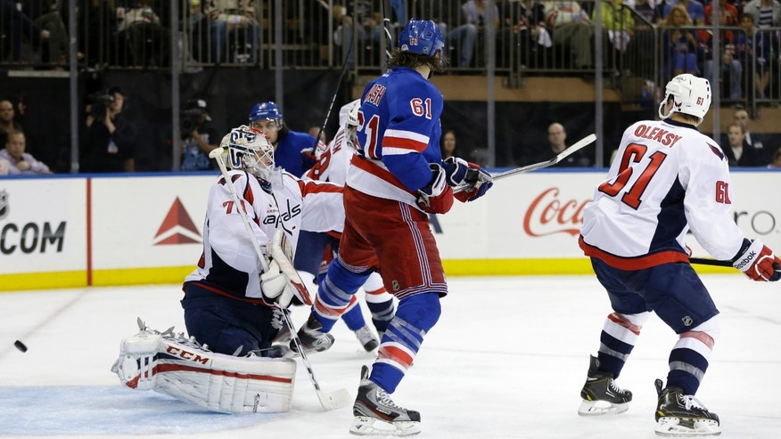 New York Rangers left wing Rick Nash (61) scores a goal past Washington Capitals goalie Braden Holtby (70) in the second period of Game 6 of their NHL Stanley Cup hockey playoff series in New York, Sunday, May 12, 2013. (AP Photo/Kathy Willens)