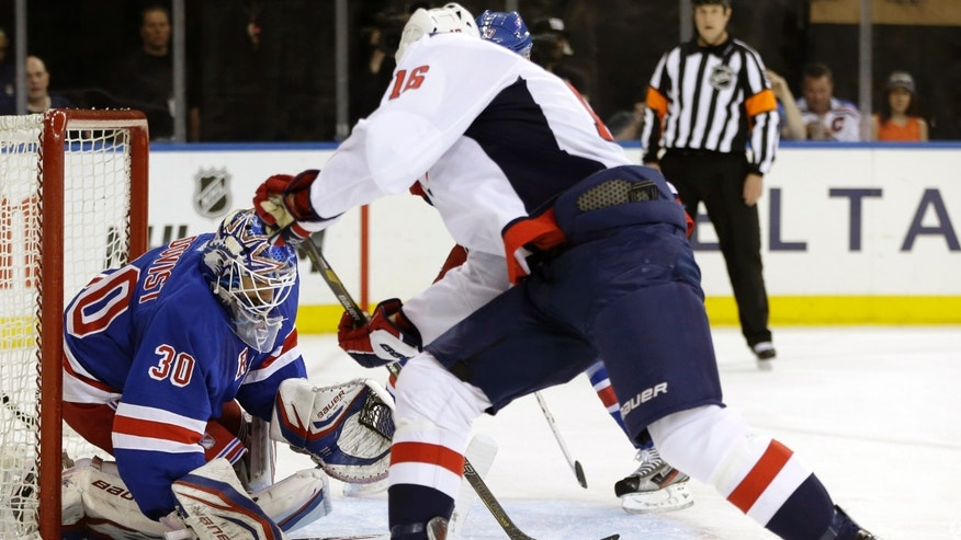 Washington Capitals right wing Eric Fehr (16)] shoots as New York Rangers goalie Henrik Lundqvist (30), of Sweden, defends in the first period of Game 6 of their NHL Stanley Cup hockey playoff series in New York, Sunday, May 12, 2013. (AP Photo/Kathy Willens)