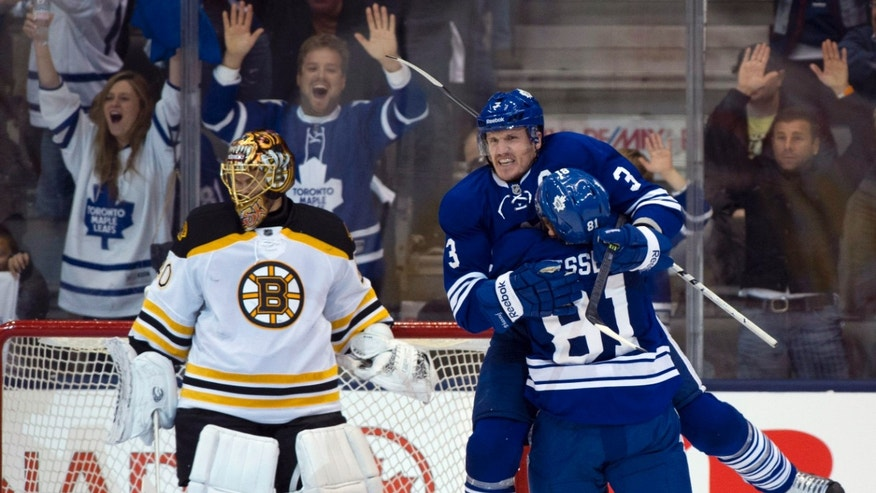 Toronto Maple Leafs defenceman Dion Phaneuf celebrates with teammate Phil Kessel (81) after scoring on Boston Bruins goalie Tuuka Rask during third period first round NHL playoff action in Toronto on Sunday May 12, 2013. (AP Photo/The Canadian Press, Frank Gunn)
