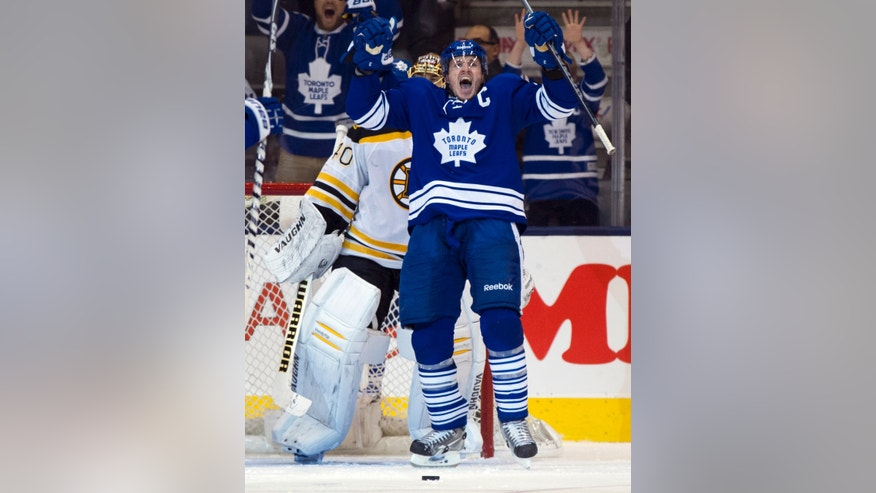 Toronto Maple Leafs defenceman Dion Phaneuf celebrates after scoring on Boston Bruins  goalie Tuuka Rask during third period first round NHL playoff action in Toronto on Sunday May 12, 2013. (AP Photo/The Canadian Press, Frank Gunn)
