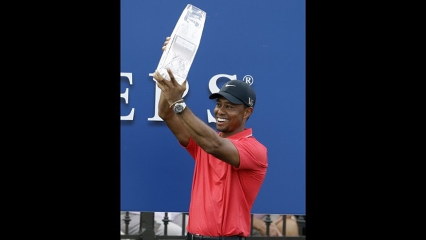 May 12, 2013: Tiger Woods raises The Players championship golf tournament trophy at TPC Sawgrass in Ponte Vedra Beach, Fla.