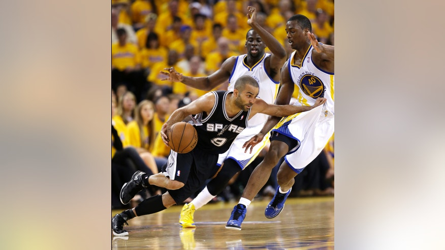 San Antonio Spurs' Tony Parker, left, dribbles next to Golden State Warriors' Draymond Green, center, and Harrison Barnes (40) during the first half of Game 4 of a Western Conference semifinal NBA basketball playoff series in Oakland, Calif., Sunday, May 12, 2013. (AP Photo/Marcio Jose Sanchez)