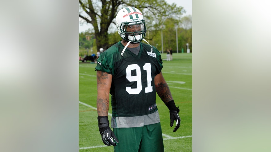 New York Jets defensive tackle Sheldon Richardson, a first-round pick out of Missouri, poses for the media after practice at NFL football rookie minicamp Friday, May 10, 2013, in Florham Park, N.J. (AP Photo/Bill Kostroun)