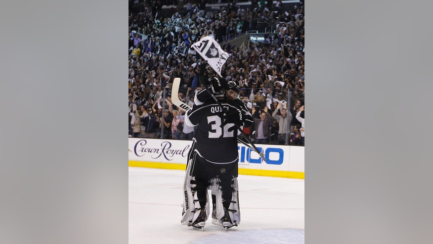 Los Angeles Kings' Drew Doughty and goalie Jonathan Quick(32) celebrate their team's 2-1 win against the St. Louis Blues in Game 6 of a first-round NHL hockey Stanley Cup playoff series in Los Angeles, Friday, May 10, 2013. (AP Photo/Jae C. Hong)
