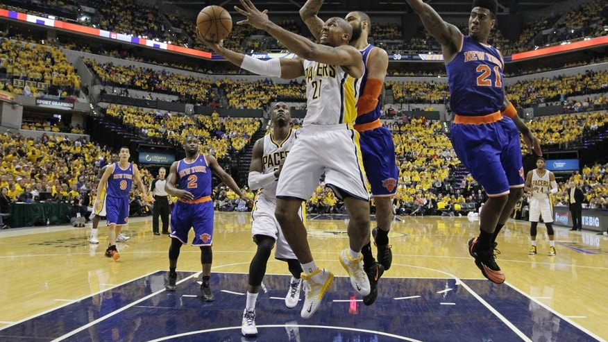 Indiana Pacers' David West (21) puts up a shot against New York Knicks' Tyson Chandler (6) during the second half of Game 3 of an Eastern Conference semifinal NBA basketball playoff series on Saturday, May 11, 2013, in Indianapolis. Indiana defeated New York 82-71. (AP Photo/Darron Cummings)
