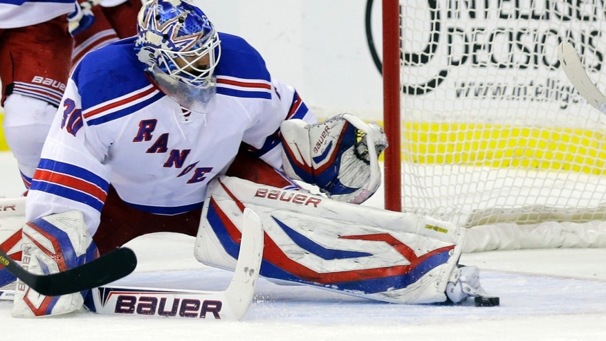 New York Rangers goalie Henrik Lundqvist (30), from Sweden, stops the puck with his skate, in the first period, of Game 7 first-round NHL Stanley Cup playoff hockey series against the Washington Capitals, Monday, May 13, 2013 in Washington. (AP Photo/Alex Brandon)