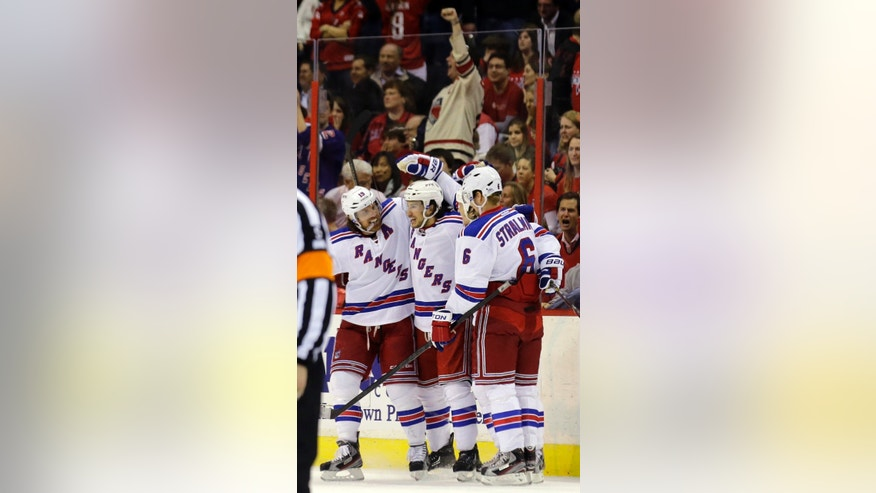 New York Rangers center Brad Richards (19),  right wing Arron Asham (45) and defenseman Anton Stralman (6), from Sweden, celebrate Asham's goal in the first period, of Game 7 first-round NHL Stanley Cup playoff hockey series against the Washington Capitals, Monday, May 13, 2013 in Washington. (AP Photo/Alex Brandon)