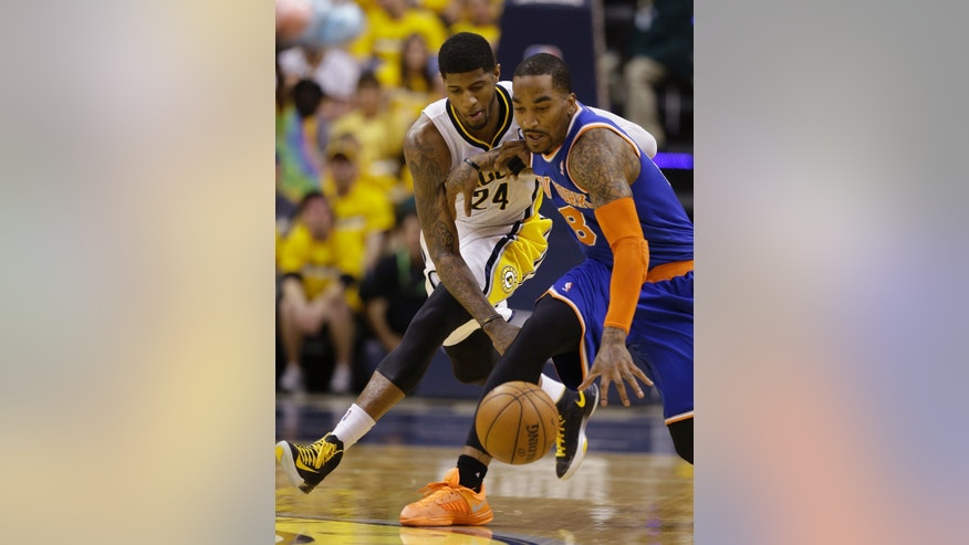 Indiana Pacers' Paul George (24) and New York Knicks' J.R. Smith (8) battle for a loose ball during the second half of Game 3 of an Eastern Conference semifinal NBA basketball playoff series on Saturday, May 11, 2013, in Indianapolis. Indiana defeated New York 82-71. (AP Photo/Darron Cummings)
