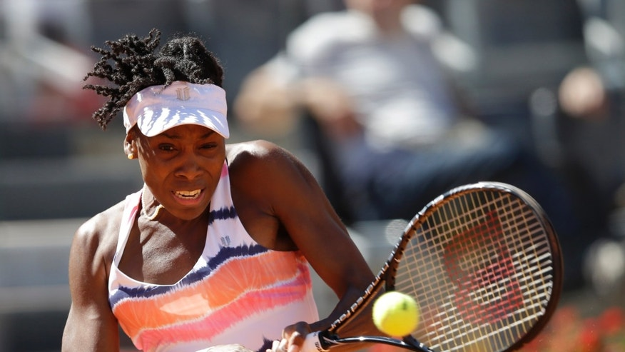 Venus Williams of the United States, returns the ball to Laura Robson of Britain during their match at the Italian Open tennis tournament in Rome, Monday, May 13, 2013. (AP Photo/Gregorio Borgia)