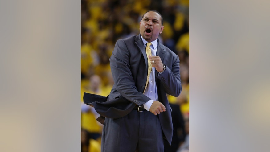 Golden State Warriors head coach Mark Jackson argues a call as his team plays the San Antonio Spurs during the second half of Game 3 of a Western Conference semifinal NBA basketball playoff series in Oakland, Calif., Friday, May 10, 2013. San Antonio won 102-92. (AP Photo/Marcio Jose Sanchez)