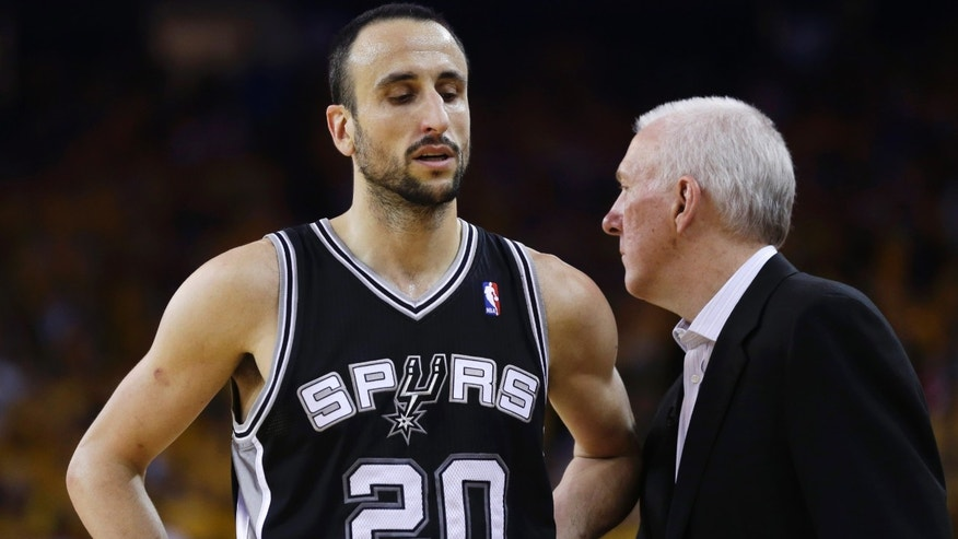 San Antonio Spurs' Manu Ginobili (20), of Argentina, stands next to head coach Gregg Popovich in the closing seconds of a loss to the Golden State Warriors in Game 4 of a Western Conference semifinal NBA basketball playoff series in Oakland, Calif., Sunday, May 12, 2013. Golden State won 97-87 in overtime. Ginobili had 21 points. (AP Photo/Marcio Jose Sanchez)