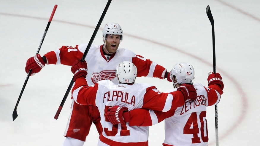 Detroit Red Wings center Valtteri Filppula, center celebrates his goal with right wing Daniel Cleary, left, and center Henrik Zetterberg during the second period in Game 7 of their first-round NHL hockey Stanley Cup playoff series against the Anaheim Ducks in Anaheim, Calif., Sunday, May 12, 2013. (AP Photo/Chris Carlson)