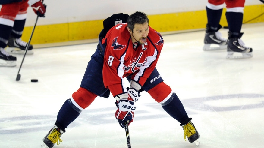 Washington Capitals left wing Alex Ovechkin (8), from Russia, skates with the puck during warmups before Game 7 first-round NHL Stanley Cup playoff hockey series against the New York Rangers, Monday, May 13, 2013, in Washington. (AP Photo/Nick Wass)