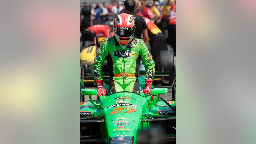 IndyCar driver James Hinchcliffe climbs into his car before starting practice for the Indianapolis 500 auto race at the Indianapolis Motor Speedway in Indianapolis, Tuesday, May 14, 2013. (AP Photo/AJ Mast)