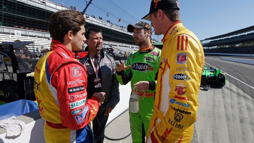 Car owner Michael Andretti, left center, talks with his drivers, left to right, Carlos Munoz, of Colombia, Ryan Hunter-Reay, and James Hinchcliffe, of Canada, during practice for the Indianapolis 500 auto race at the Indianapolis Motor Speedway in Indianapolis, Monday, May 13, 2013. (AP Photo/Darron Cummings)