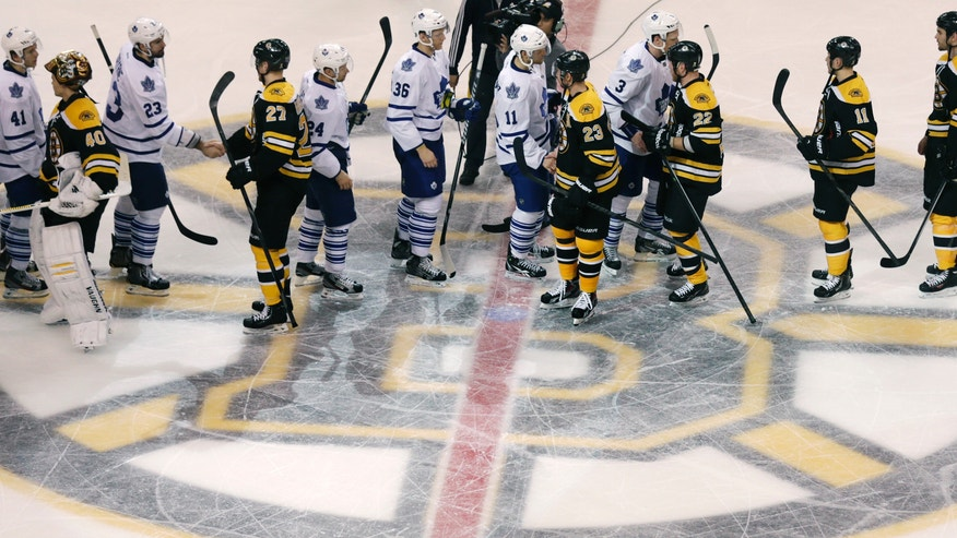 Toronto Maple Leafs and Boston Bruins players shake hands after overtime in Game 7 of their NHL hockey Stanley Cup playoff series in Boston, Monday, May 13, 2013. The Bruins won 5-4. (AP Photo/Charles Krupa)