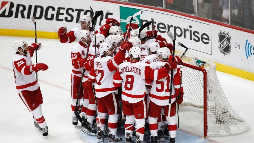 The Detroit Red Wings celebrate their 3-2 win over the Anaheim Ducks in Game 7 of their first-round NHL hockey Stanley Cup playoff series in Anaheim, Calif., Sunday, May 12, 2013. (AP Photo/Chris Carlson)