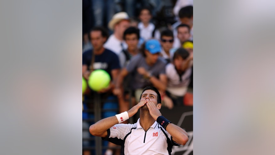 Serbia's Novak Djokovic celebrates after winning his match against Spain's Albert Montanes at the Italian Open tennis tournament in Rome, Tuesday, May 14, 2013. Djokovic won 6-2, 6-3. (AP Photo/Gregorio Borgia)
