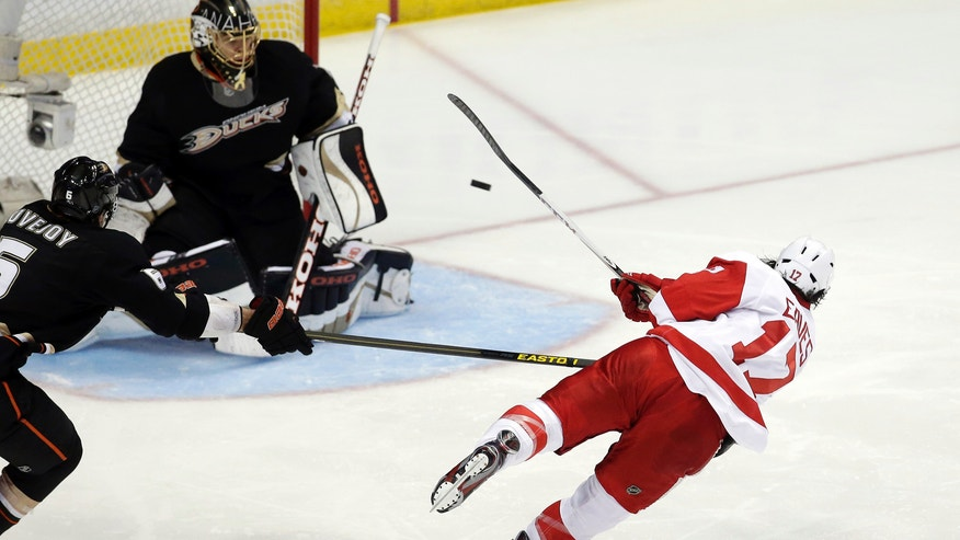 Detroit Red Wings right wing Patrick Eaves, right, takes a shot at Anaheim Ducks goalie Jonas Hiller during the second period in Game 7 of their first-round NHL hockey Stanley Cup playoff series in Anaheim, Calif., Sunday, May 12, 2013. (AP Photo/Chris Carlson)