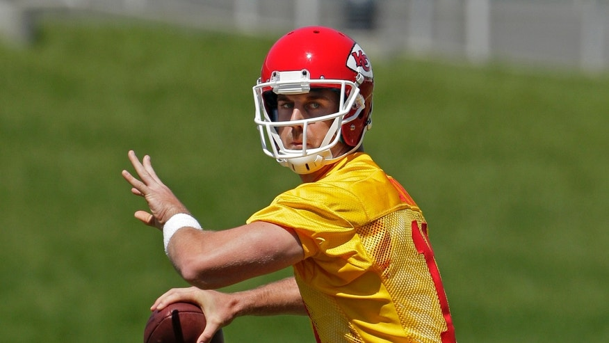 Kansas City Chiefs quarterback Alex Smith throws during an NFL football training camp Tuesday, May 14, 2013, in Kansas City, Mo. (AP Photo/Charlie Riedel)