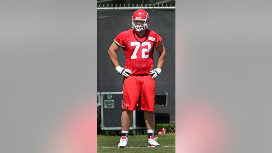 Kansas City Chiefs tackle Eric Fisher watches a drill during a NFL football training camp Tuesday, May 14, 2013, in Kansas City, Mo. (AP Photo/Charlie Riedel)