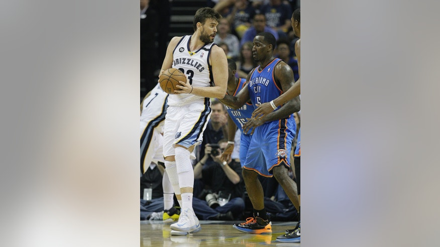 Memphis Grizzlies center Marc Gasol (33) works against Oklahoma City Thunder center Kendrick Perkins (5) in the first half of Game 4 in a Western Conference semifinal NBA basketball playoff series in Memphis, Tenn., Monday, May 13, 2013. (AP Photo/Danny Johnston)