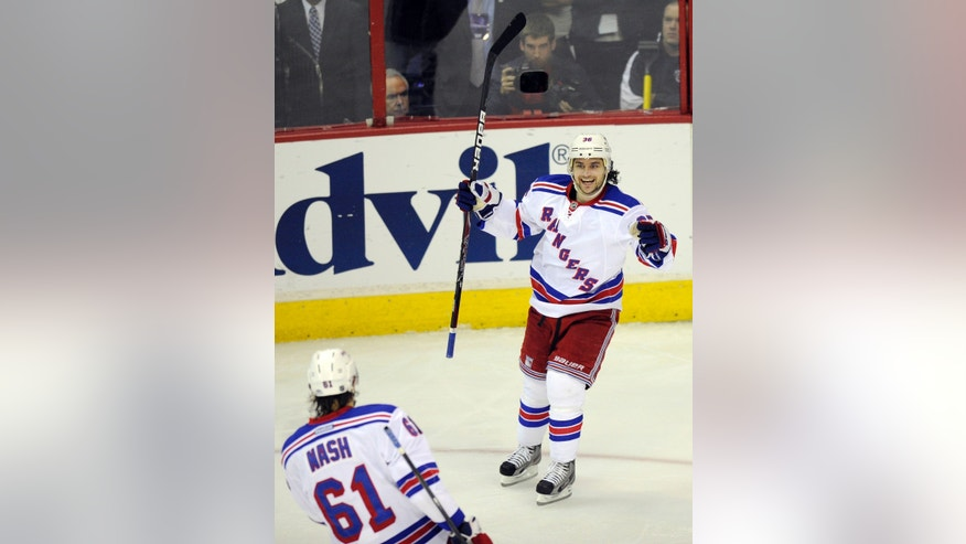 New York Rangers right wing Mats Zuccarello (36), from Norway, celebrates his goal with Rick Nash (61) against the Washington Capitals during the third period of Game 7 first-round NHL Stanley Cup playoff hockey series, Monday, May 13, 2013, in Washington. The Rangers won 5-0. (AP Photo/Nick Wass)