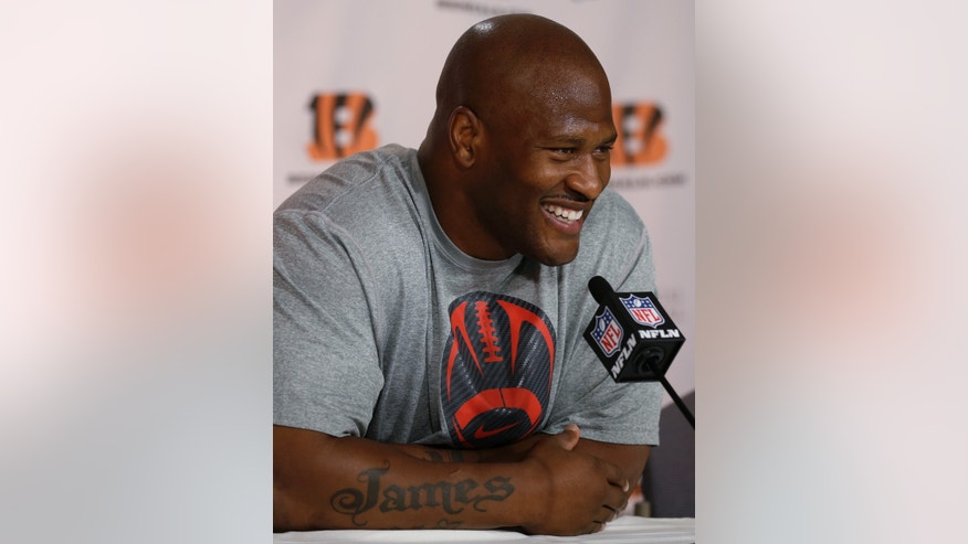 Cincinnati Bengals linebacker James Harrison speaks during an NFL football news conference, Tuesday, May 14, 2013, at  Paul Brown Stadium in Cincinnati. Harrison signed with the Bengals as a free agent from the Pittsburgh Steelers. (AP Photo/Al Behrman)