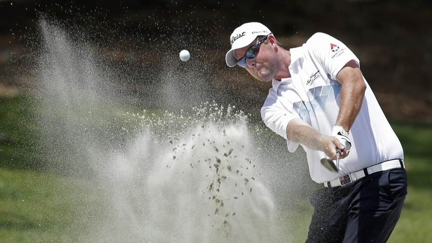 Marc Leishman, of Australia, hits from a bunker on the second hole during the third round of The Players championship golf tournament at TPC Sawgrass, Saturday, May 11, 2013, in Ponte Vedra Beach, Fla. (AP Photo/Chris O'Meara)