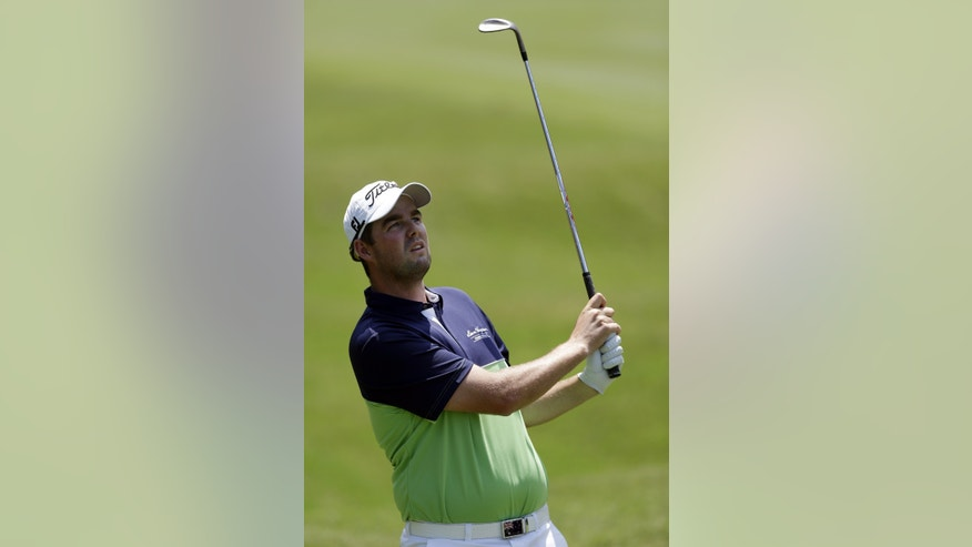 Marc Leishman, of Australia, watches his shot from the first fairway during the final round of The Players championship golf tournament at TPC Sawgrass, Sunday, May 12, 2013, in Ponte Vedra Beach, Fla. (AP Photo/John Raoux)