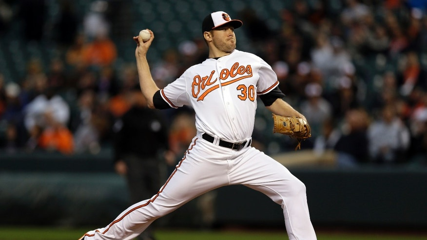 Baltimore Orioles starting pitcher Chris Tillman throws to the San Diego Padres in the first inning of an interleague baseball game in Baltimore, Tuesday, May 14, 2013. (AP Photo/Patrick Semansky)