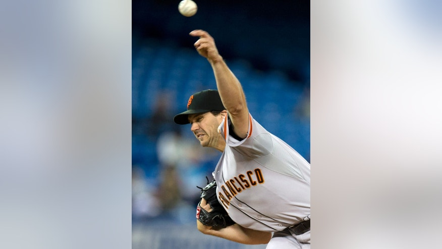 San Francisco Giants starting pitcher Barry Zito throws to the Toronto Blue Jays during the first inning of a baseball game Tuesday, May 14, 2013, in Toronto. (AP Photo/The Canadian Press, Frank Gunn)