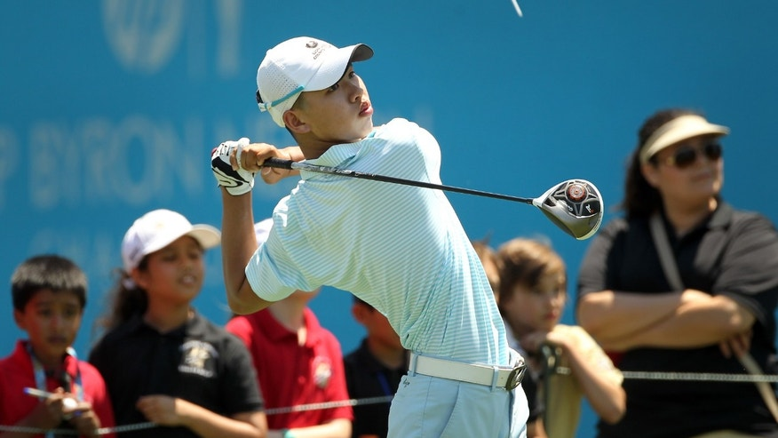 In this photo taken Tuesday, May 14, 2013, Guan Tianlang, 14, from China, tees off on the 18th hole during a practice round at Byron Nelson Championship golf tournament in Irving, Texas. (AP Photo/The Dallas Morning News, Brad Loper)  MANDATORY CREDIT; MAGS OUT; TV OUT; INTERNET USE AP MEMBERS ONLY; NO SALES.