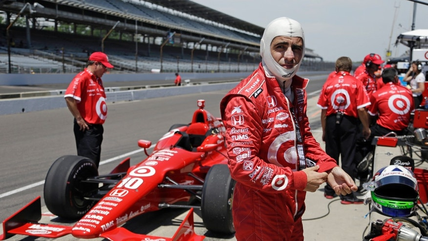 Dario Franchitti, of Scotland, prepares to drive during practice for the Indianapolis 500 auto race at the Indianapolis Motor Speedway in Indianapolis, Wednesday, May 15, 2013. (AP Photo/Michael Conroy)