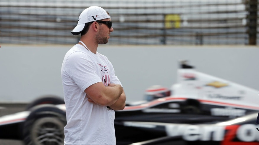 Indianapolis Colts quarterback Andrew Luck watches cars on the track during practice for the Indianapolis 500 auto race, at Indianapolis Motor Speedway in Indianapolis, Wednesday, May 15, 2013. (AP Photo/Darron Cummings)