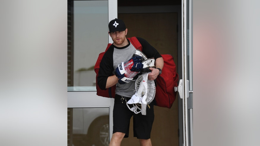 Washington Capitals' Karl Alzner carries things to his vehicle at the Kettler Iceplex in Arlington, Va., Wednesday, May 15, 2013. The Capitals were eliminated in the first round of the NHL Stanley Cup playoffs by the New York Rangers. The Capitals have had six consecutive playoff appearances and have failed to get past the second round. (AP Photo/Susan Walsh)
