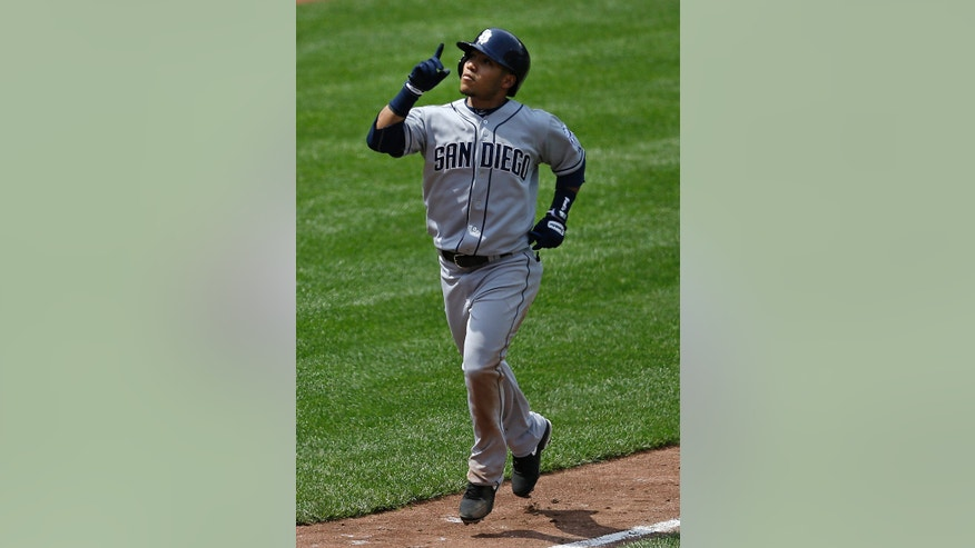 San Diego Padres' Alexi Amarista gestures as he nears home plate after hitting a two-run home run in the seventh inning of an interleague baseball game against the Baltimore Orioles in Baltimore, Wednesday, May 15, 2013. San Diego won 8-4. (AP Photo/Patrick Semansky)