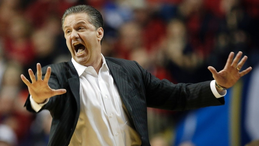 FILE - In this March 15, 2013, file photo, Kentucky head coach John Calipari reacts to a call against the Vanderbilt during the first half of an NCAA college basketball game at the Southeastern Conference tournament in Nashville, Tenn. After a disappointing season that left the Wildcats out of the NCAA tournament, the coach is mindful not to put too much on a recruiting class considered the best in school history. (AP Photo/Dave Martin, File)