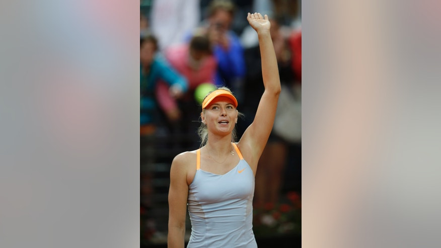 Russia's Maria Sharapova celebrates after defeating Spain's Garbine Muguruza during their match at the Italian Open tennis tournament in Rome, Wednesday, May 15, 2013. Sharapova won 6-2, 6-2. (AP Photo/Andrew Medichini)