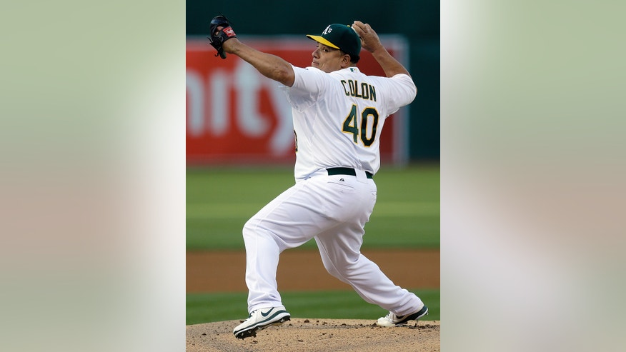 Oakland Athletics' Bartolo Colon throws to a Texas Rangers batter in the first inning of a baseball game Tuesday, May 14, 2013, in Oakland, Calif. (AP Photo/Ben Margot)