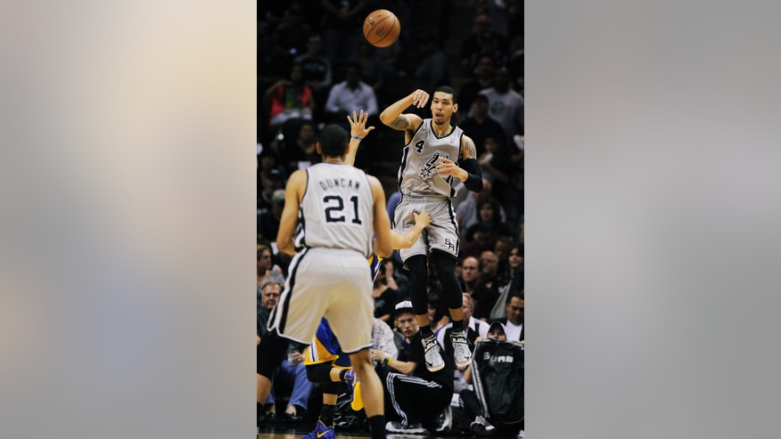 San Antonio Spurs' Danny Green (4) looks to pass against the Golden State Warriors during the first half of Game 5 of the Western Conference semifinal NBA basketball playoff series, Tuesday, May 14, 2013, in San Antonio.(AP Photo/Darren Abate)