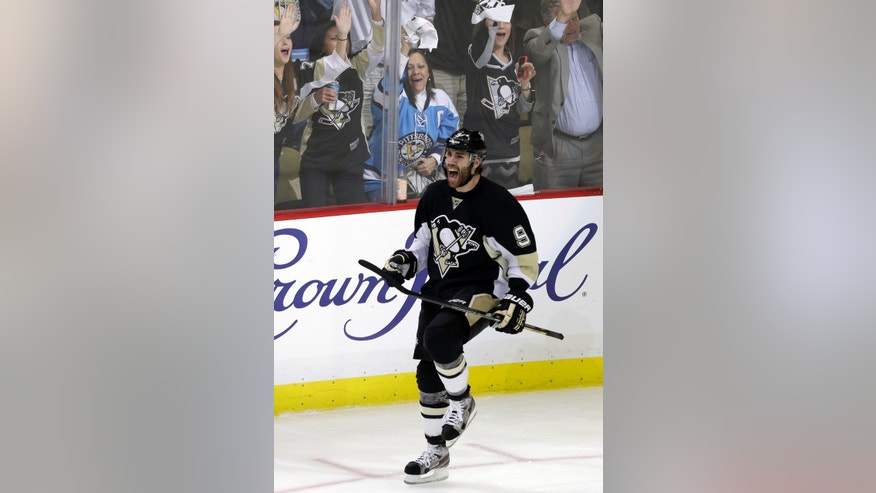 Pittsburgh Penguins' Pascal Dupuis (9) celebrates his short-handed goal in the third period of Game 1 of an NHL hockey Stanley Cup second-round playoff series against the Ottawa Senators in Pittsburgh Tuesday, May 14, 2013. The Penguins won 4-1. (AP Photo/Gene J. Puskar)