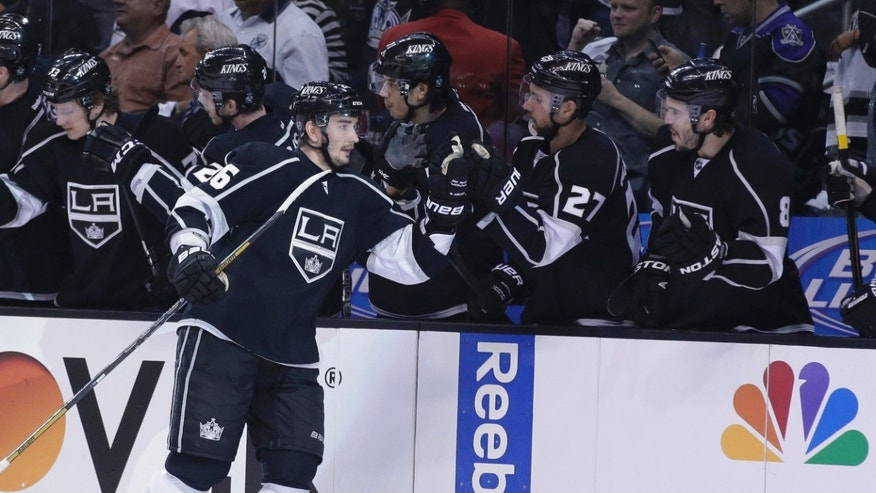 Los Angeles Kings' Slava Voynov (26) celebrates his first period goal against the San Jose Sharks in Game 1 of their second-round NHL hockey Stanley Cup playoff series, in Los Angeles on Tuesday, May 14, 2013. (AP Photo/Chris Carlson)