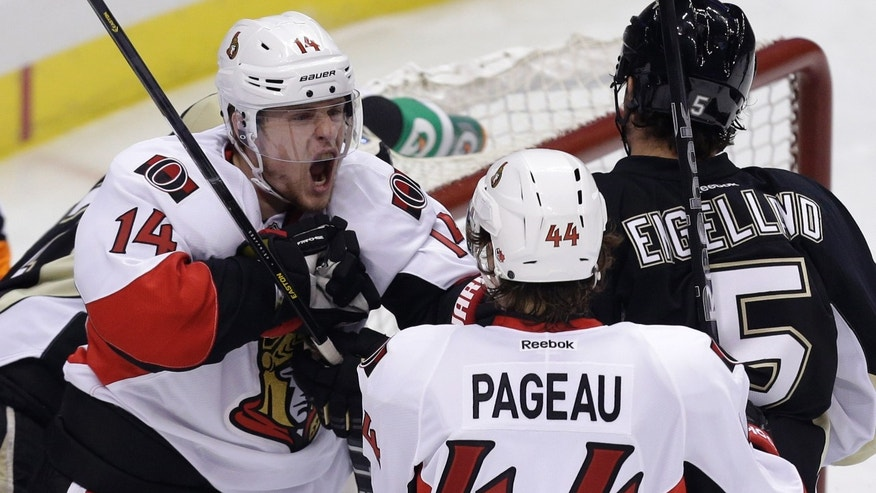 Ottawa Senators' Jean-Gabriel Pageau (44) celebrates with teammate Colin Greening (14) after scoring in the first period of Game 1 of an NHL hockey Stanley Cup second-round playoff series against the Pittsburgh Penguins in Pittsburgh, Tuesday, May 14, 2013. (AP Photo/Gene J. Puskar)