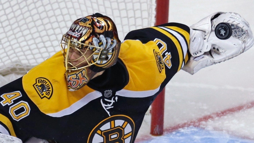 Boston Bruins goalie Tuukka Rask (40) looks the wrong way for the rebound against the Toronto Maple Leafs during the third period in Game 7 of their NHL hockey Stanley Cup playoff series in Boston, Monday, May 13, 2013. (AP Photo/Charles Krupa)