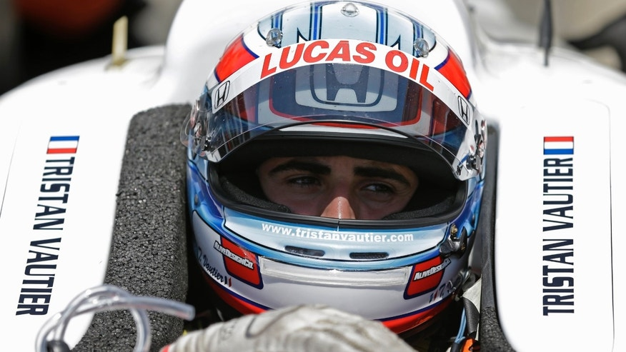 Tristan Vautier, of France, talks with his crew as he sits in his car during practice for the Indianapolis 500 auto race at the Indianapolis Motor Speedway in Indianapolis, Wednesday, May 15, 2013. (AP Photo/Michael Conroy)